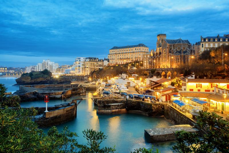 Biarritz Old Town, Basque Country, France, at night. Biarritz Old Town, port and St Eugenie church, Basque Country, France, in late evening light stock images