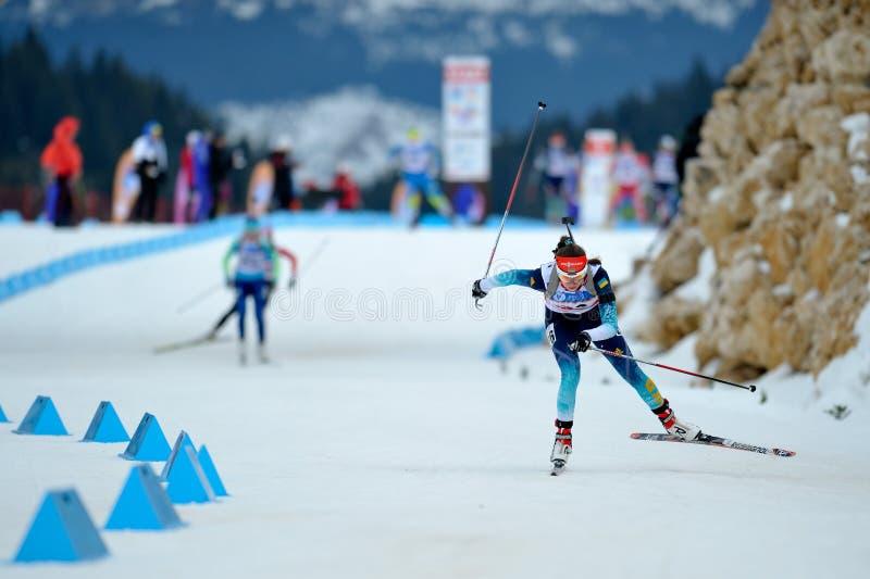 Biathlon ski competitor royalty free stock photography