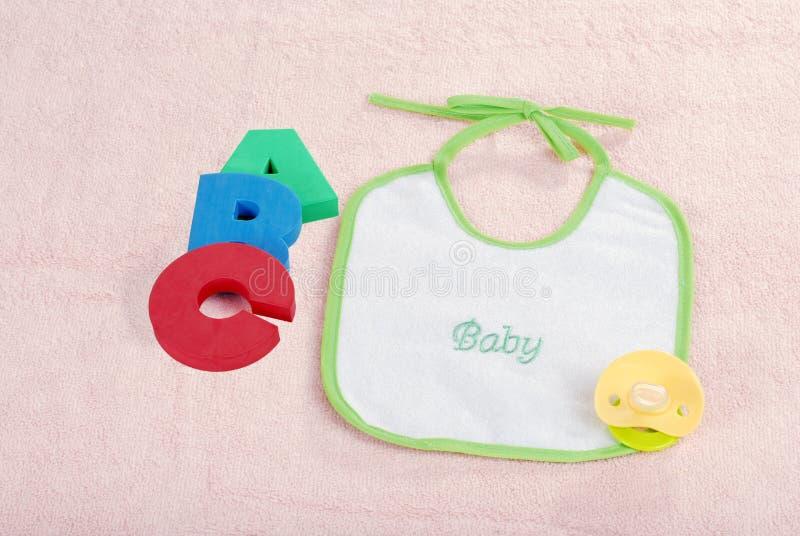 Bib do bebê com letras de A B C foto de stock