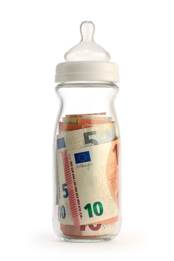 Biberón aislado que contiene el dinero imagen de archivo libre de regalías