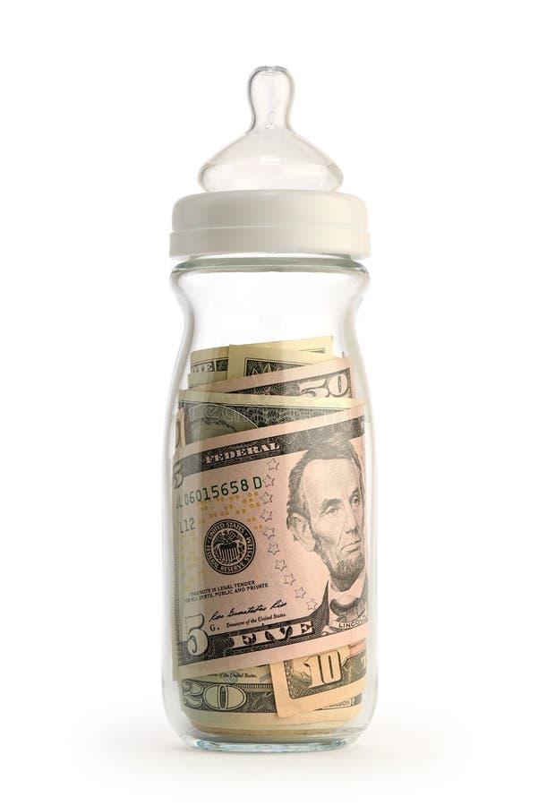 Biberón aislado que contiene el dinero fotografía de archivo libre de regalías