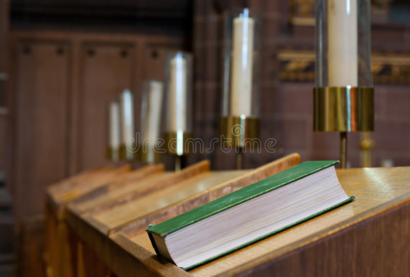 Bible on bench in church. Bible on wooden bench in church royalty free stock photos