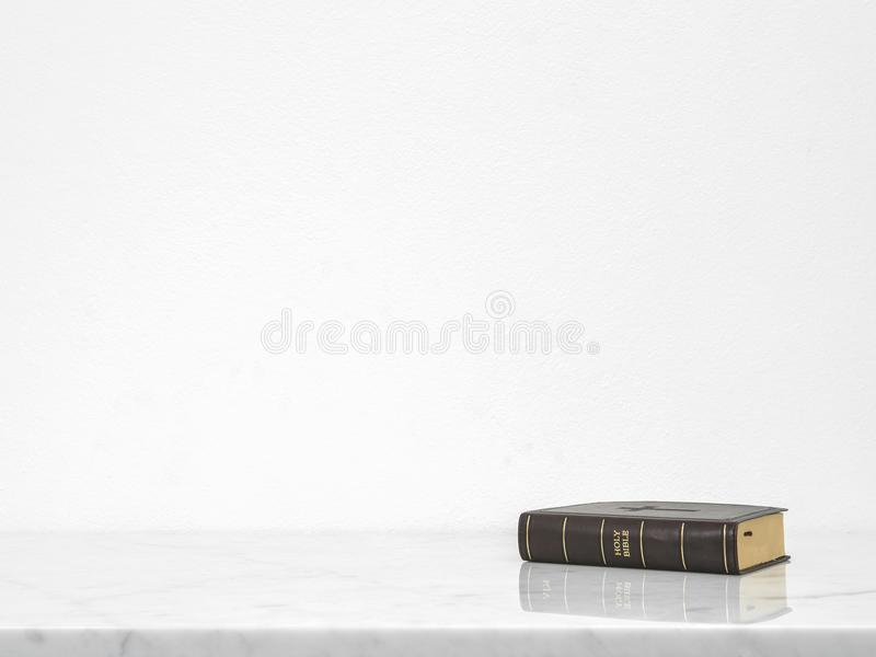 Bible book put on white marble counter desk table top.  stock photography