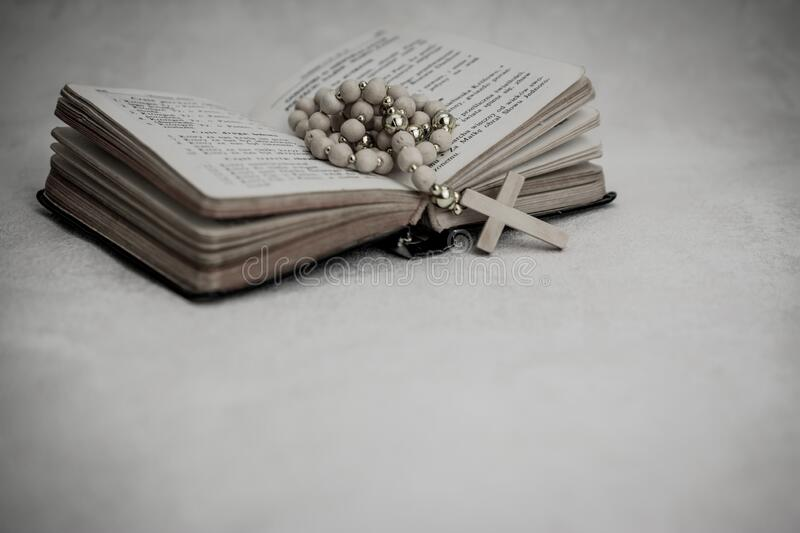 Bible book with rosary beads. Belief, bible, study, verses, catholic, christ, christian, christianity, church, concept, confess, cross, crown, thorn, crucifix stock images