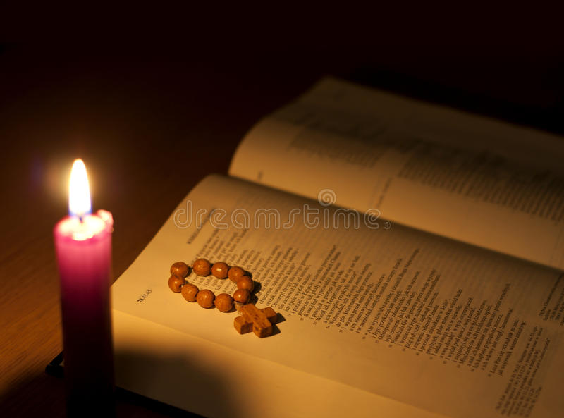 Bible and candle stock image