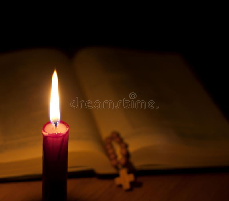 Bible and candle royalty free stock photography