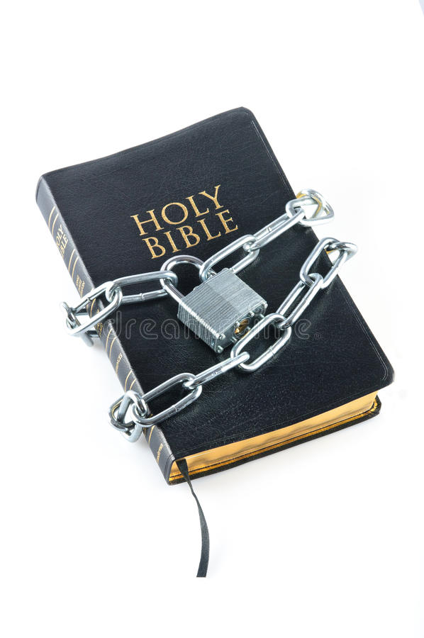 Bible closed with a chain lock. On a close-up stock photo