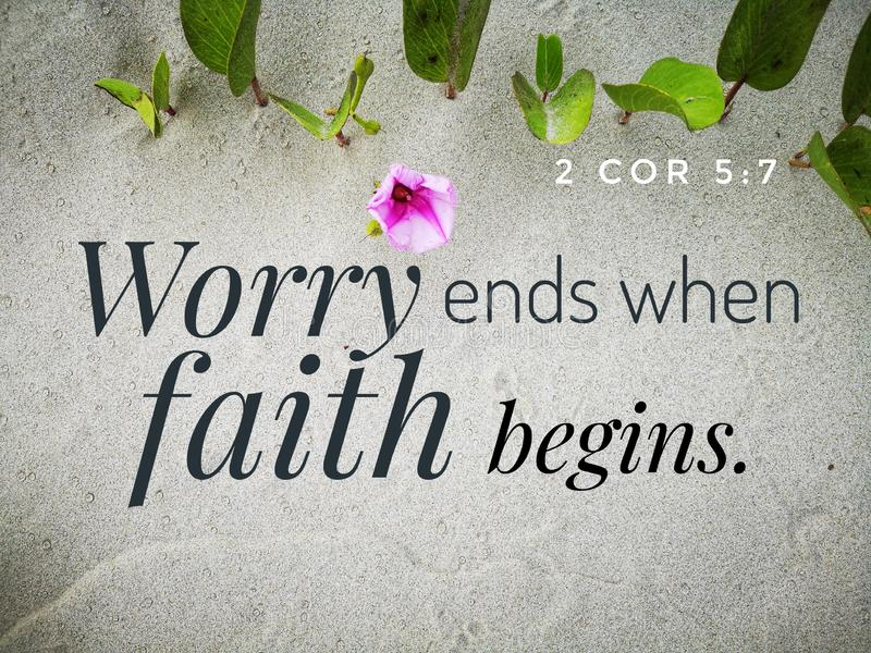 Worry ends when faith begins with bible verse design for Christianity with sandy beach background. royalty free stock image