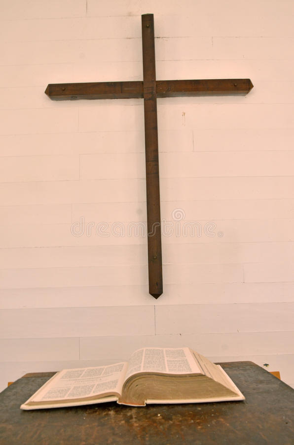 Bible and The Cross. A Bible on the pulpit and a cross on the wall in the church in the Cataloochee valley stock photo