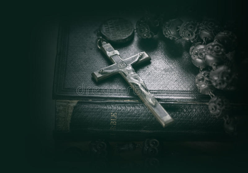 Bible and cross religious concept image. Close up photo of bible and cross religious concept image royalty free stock images