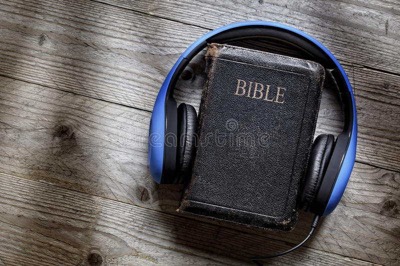 Bible and headphones royalty free stock photo
