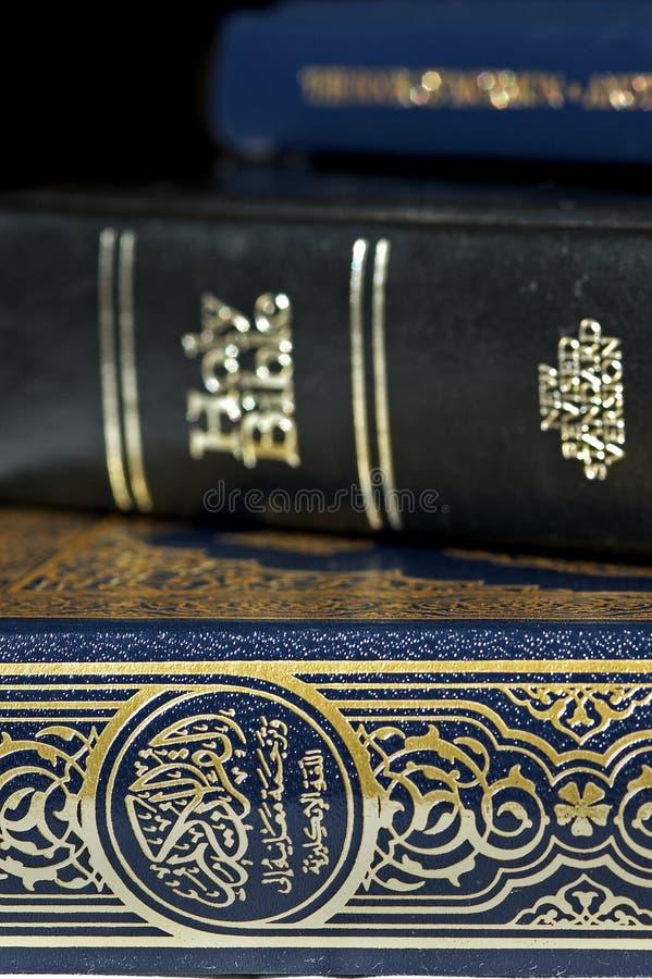 Bible And Koran (Qur An) And Book Of Mormon Stock Photos
