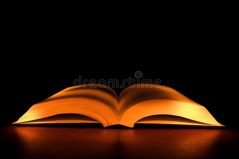 Bible open. A bible photographed in light panting