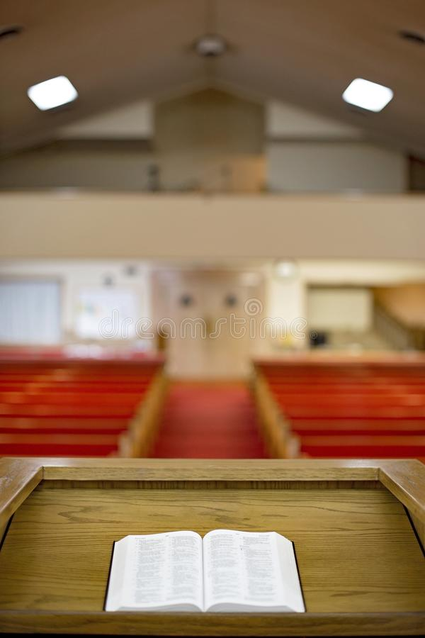 Bible on the Pulpit. In a Church Auditorium stock image
