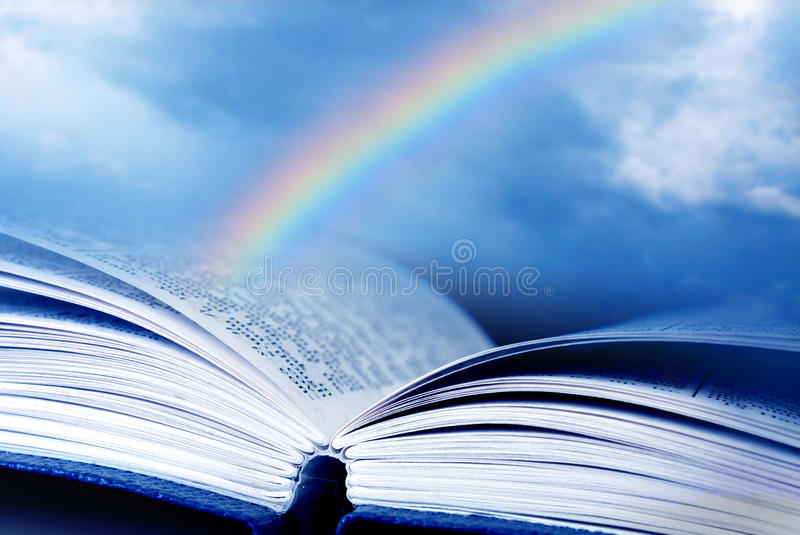 Bible with rainbow. Bible and rainbow with the background of blue sky