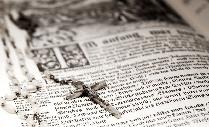 Bible and Rosary stock photo
