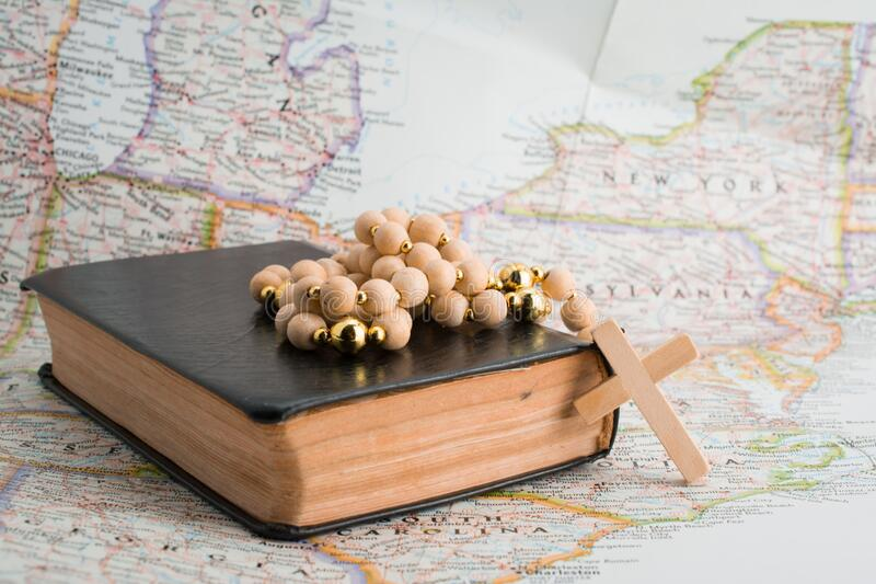 Bible rosary beads on map. Pray for New York. America, new, york, united, states, belief, bible, study, verses, catholic, christ, christian, christianity royalty free stock images