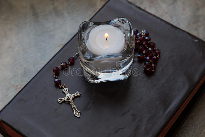 Bible with Rosary and Candle royalty free stock images