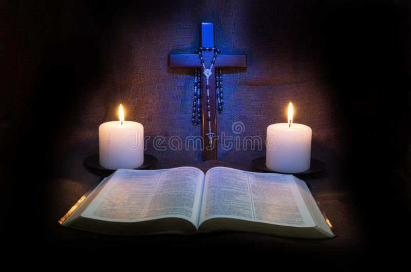 Bible, Rosary, Crucifix and Two Candles royalty free stock photography