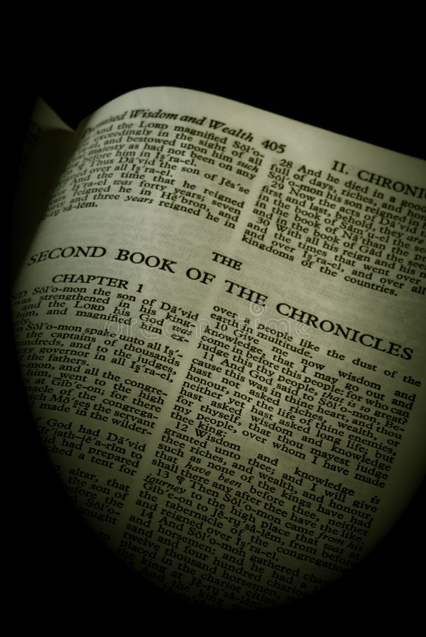 Bible series chronicles II sepia. Bible series, detail of an old antique holy bible against a black background open to the second book of the chronicles old royalty free stock photo