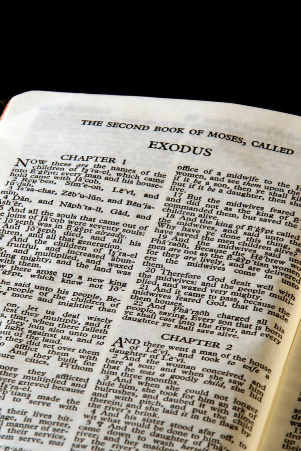 Bible series exodus. Detail of antique holy bible open to the second book of moses called exodus in the old testament royalty free stock image