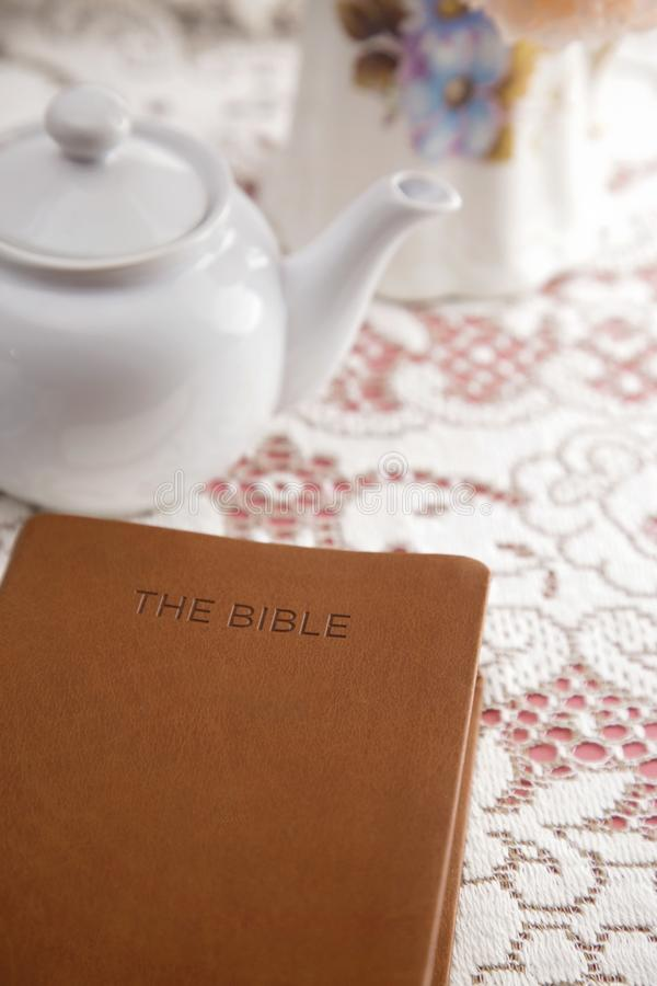 Bible Set Out with Tea for a Ladies Bible Study. A Bible Set Out with Tea for a Ladies Bible Study royalty free stock image