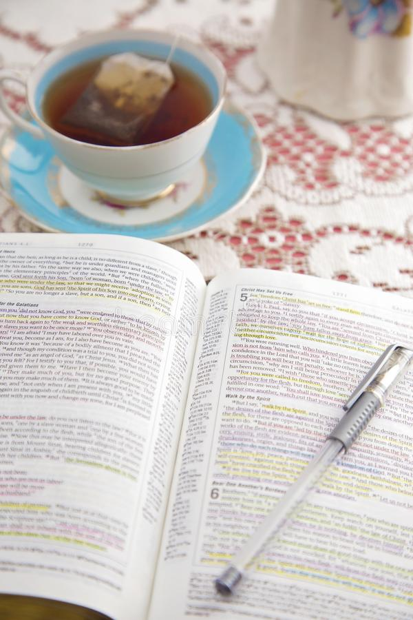 Bible Set Out with Tea for a Ladies Bible Study. A Bible Set Out with Tea for a Ladies Bible Study royalty free stock photos