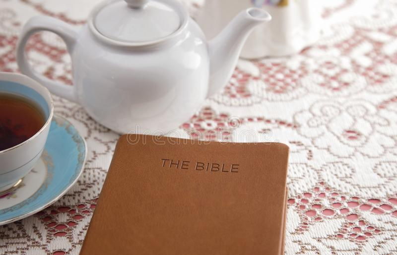 Bible Set Out with Tea for a Ladies Bible Study. A Bible Set Out with Tea for a Ladies Bible Study stock image