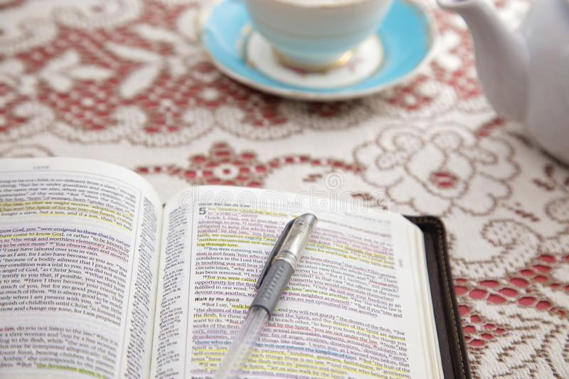 Bible Set Out with Tea for a Ladies Bible Study. A Bible Set Out with Tea for a Ladies Bible Study royalty free stock photography