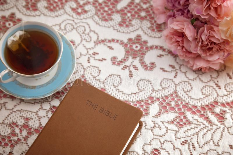 Bible Set Out with Tea for a Ladies Bible Study. A Bible Set Out with Tea for a Ladies Bible Study stock photography
