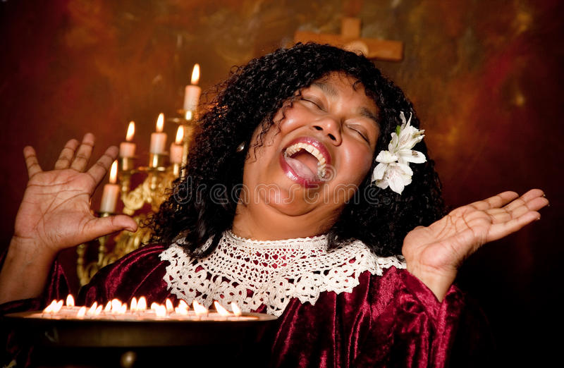 Bible singer. Negro spiritual gospel singer singing a hymn royalty free stock photography