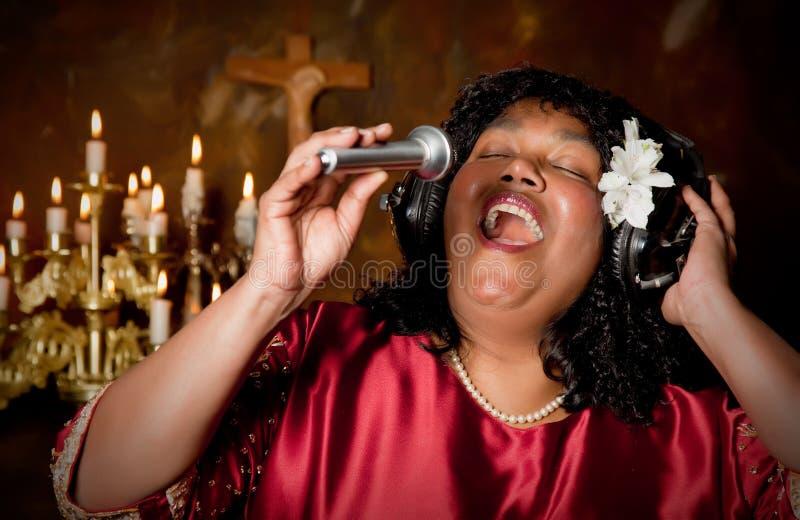 Bible singer. Negro spiritual gospel singer singing a hymn stock photography