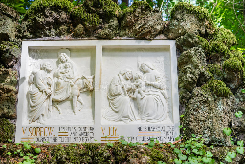 Bible story on stone tablet. Bible story of Joseph and Mary with Jesus on stone tablet royalty free stock photo