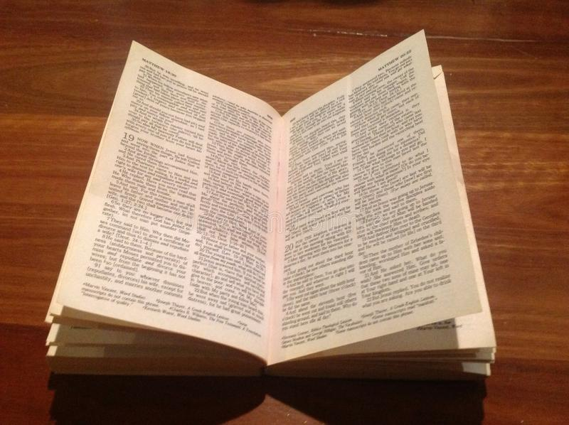 Bible on Wood. Open Bible on the book of Matthew against wood boards royalty free stock photography