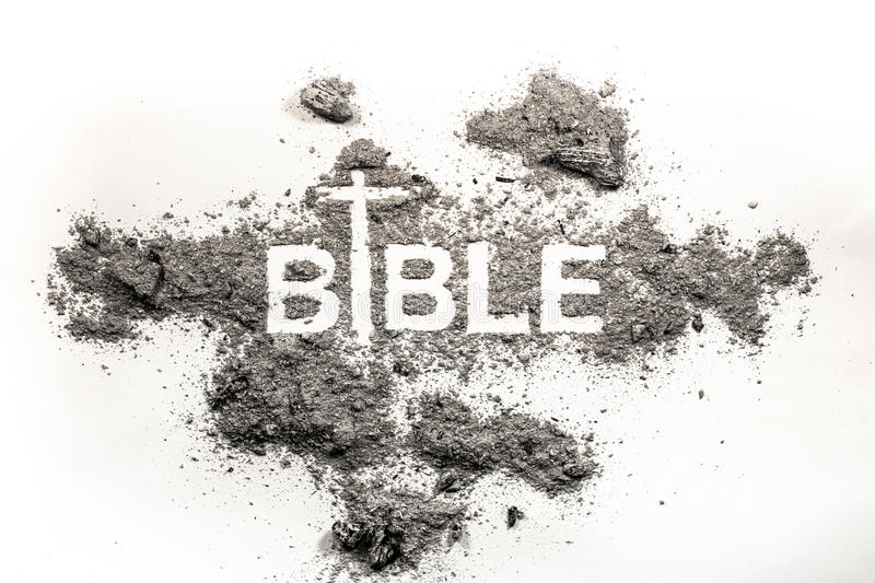 Bible word written in ash, dust and cross drawing as religion, a stock image