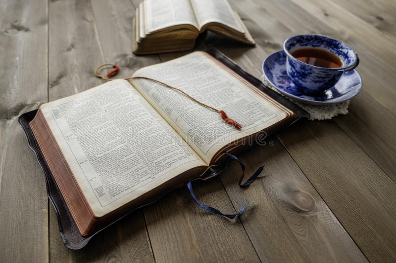Bibles and cup of tea on wood table royalty free stock photo