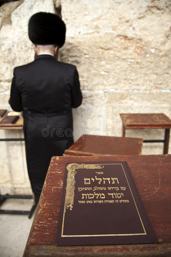 Book of Psalms at Wailing Wall. The biblical book of psalms resting on a pedistal in front of the wailing wall in the old city of Jerusalem, Israel. Defocused royalty free stock images