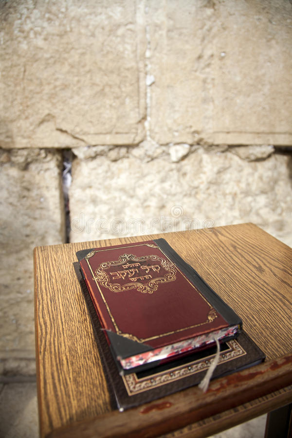 Book of Psalms at Wailing Wall. The biblical book of psalms resting on a pedistal in front of the wailing wall in the old city of Jerusalem, Israel. Defocused stock photos