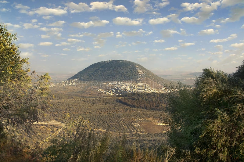Biblical Mount Tavor and the Arab village stock photos