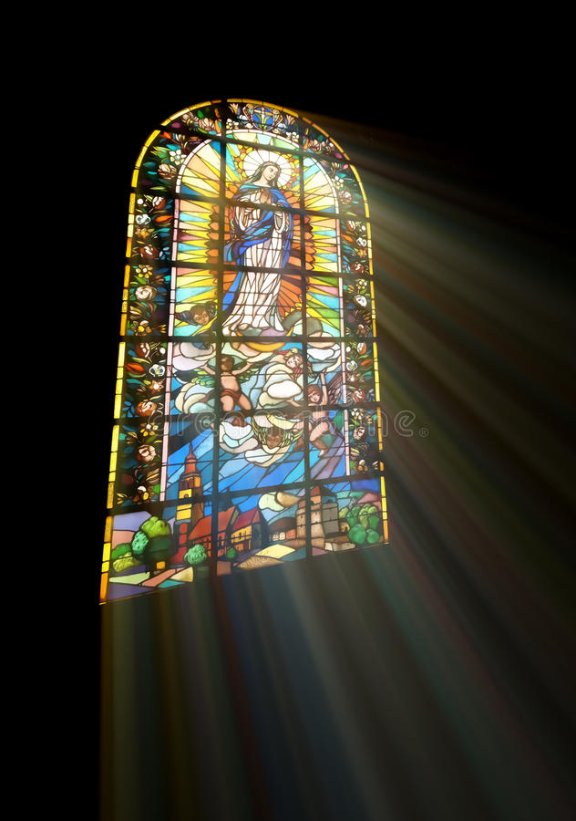 Biblical stained glass. With rays of light shining through royalty free stock photo