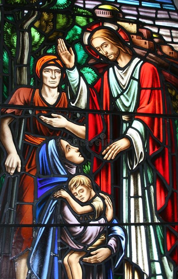 Biblisches heilendes Fenster stockfoto