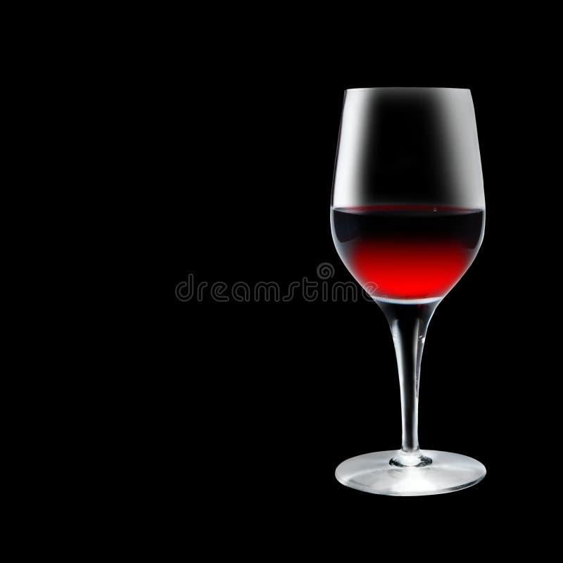 Bicchiere di vino su priorità bassa nera immagini stock libere da diritti
