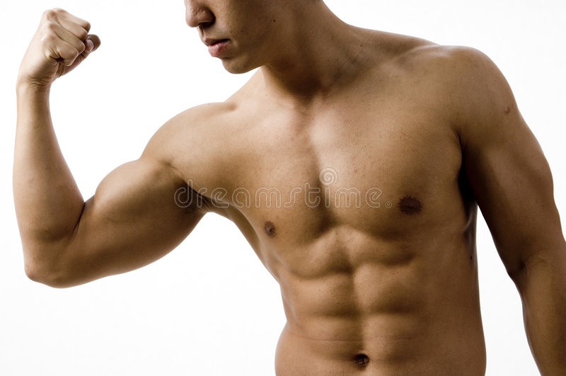 Bicep Curl. A young man flexes his bicep stock images