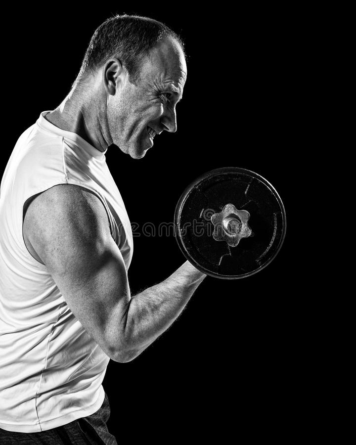 Bicep Curl. Exercise with dumbbell. Studio shot over black royalty free stock image