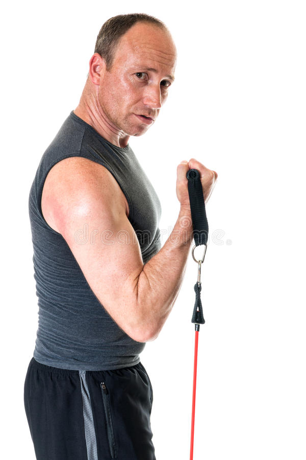 Bicep Curl. Exercise with resistance band. Studio shot over white stock image