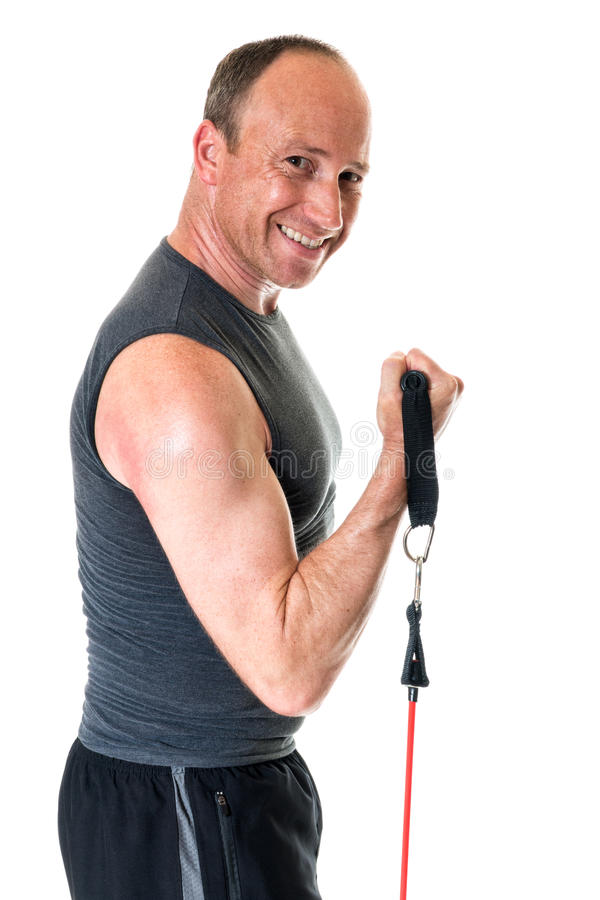 Bicep Curl. Exercise with resistance band. Studio shot over white stock images