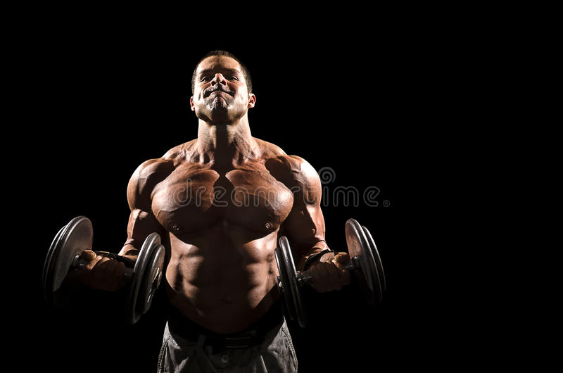Bicep Curl. Strong male doing a bicep curl with weights royalty free stock photos
