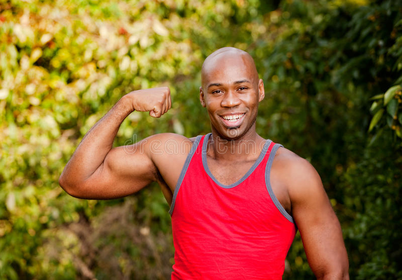 Bicep Muscle. An African American man flexing his Bicep stock images