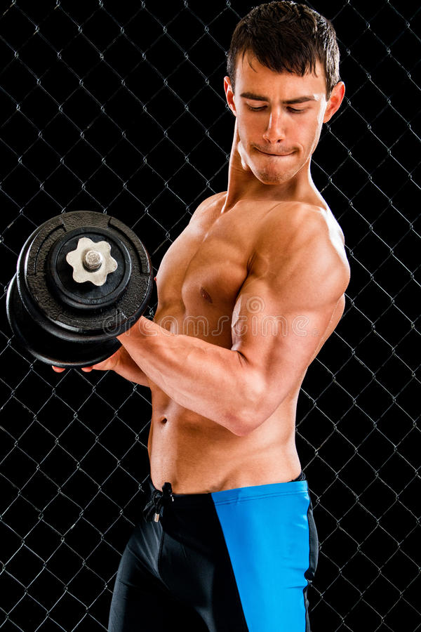 Biceps Curl Exercise. Studio shot over black royalty free stock image