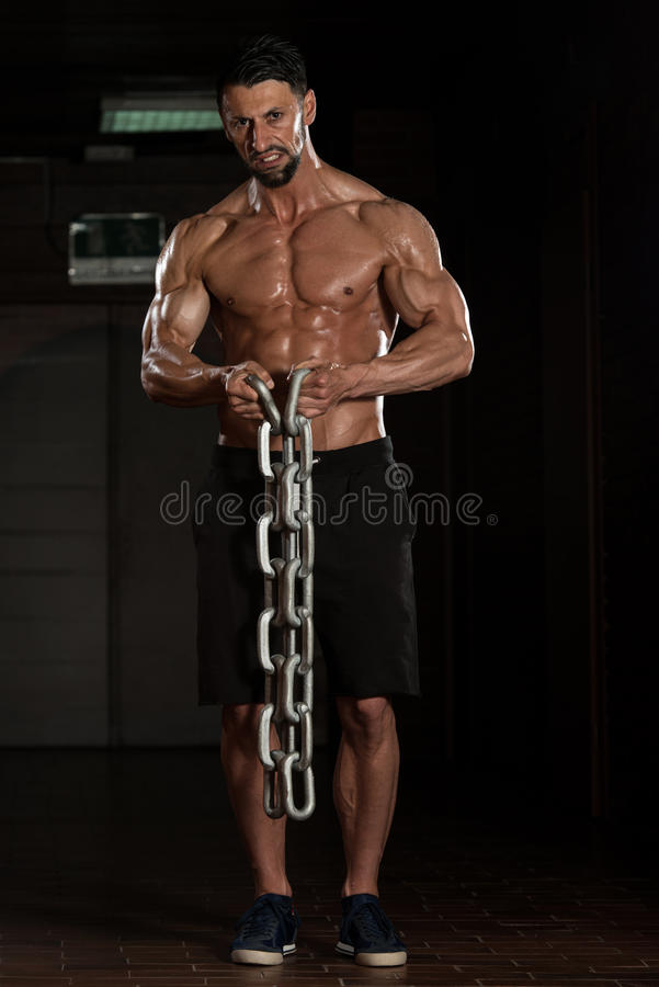 Biceps Exercise With Chains. Healthy Bodybuilder Exercising Biceps With Chains stock photo